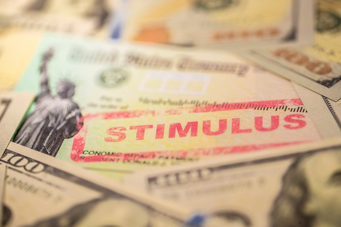 Stimulus check with hundred dollar bills