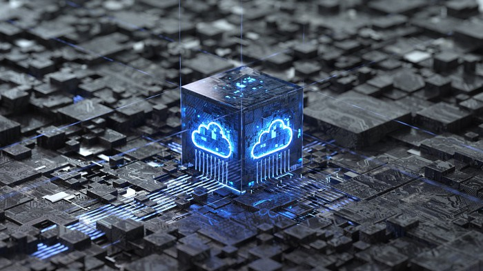 An illuminated blue cloud on processor housing, which is surrounded by circuitry.