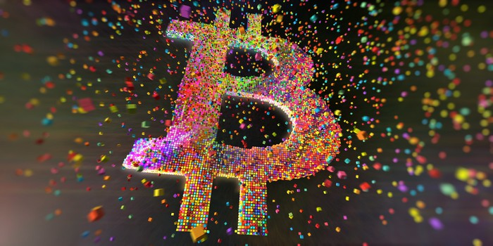 Bitcoin logo made up of small colored cubes.