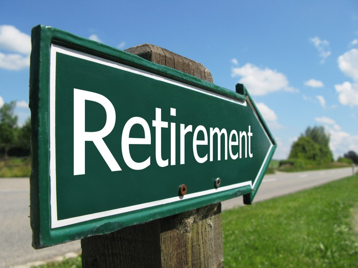 A green sign shaped like an arrow says retirement.