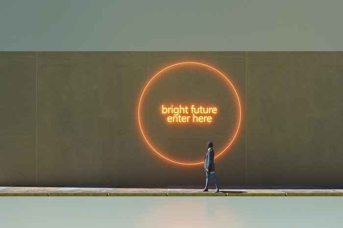 "A graffiti portal on a wall labeled ""bright future, enter here""."