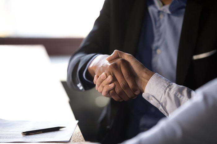People making a deal with a handshake.