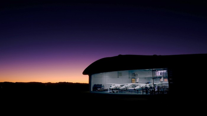 VSS Unity and VMS Eve in their hangar in New Mexico at daybreak