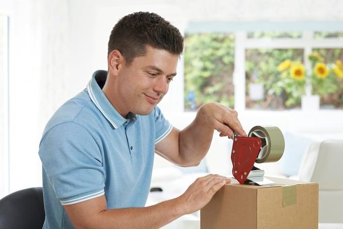 Man taping up a box