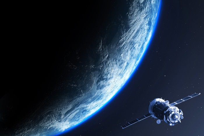 A satellite with the Earth behind it.