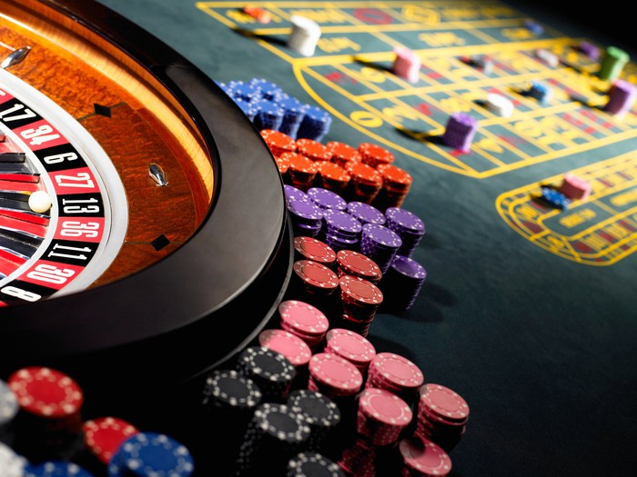 A casino game table with poker chips on it.