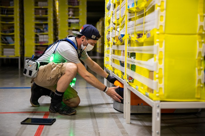 An Amazon worker in a warehouse.