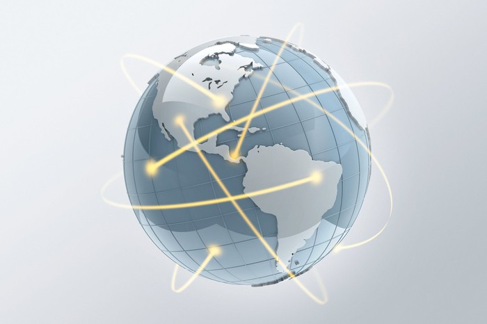 A globe with yellow lines circling around it.