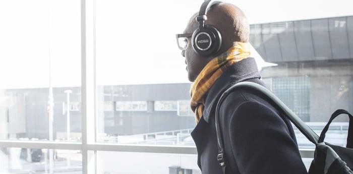 A man wears a pair of Koss headphones.