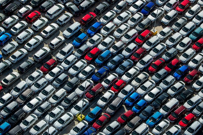 An aerial view of parked cars.