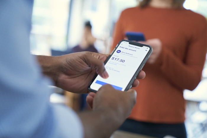 A customer navigating U.S. Bank's mobile app on his smartphone.