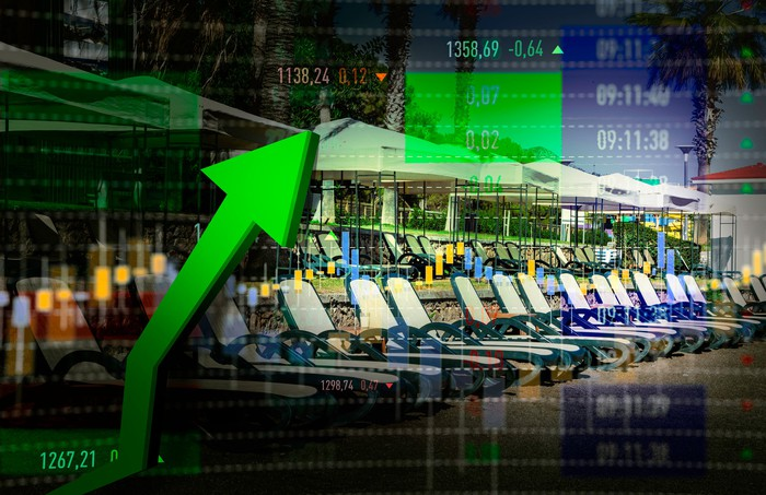 A digital stock graph with lounge chairs in the background.