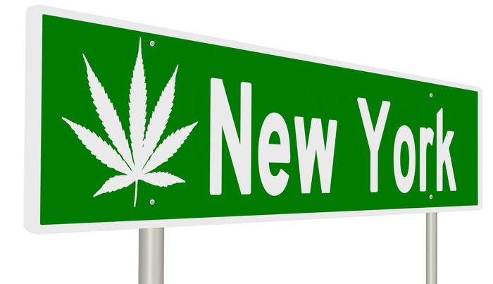 """Street sign with a cannabis leaf next to the words: """"New York."""""""