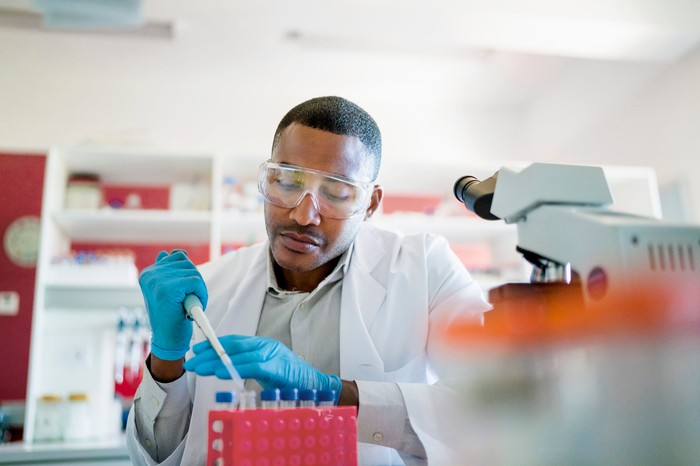 Scientist with pipette