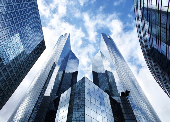 Sky scraper buildings against a cloudy blue sky