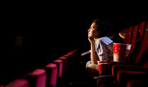 Woman Sitting in Movie Theater