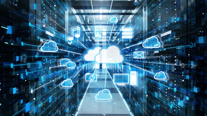 A cloud in the middle of a data center that's connected to multiple wireless devices.