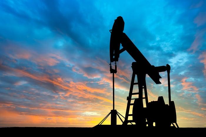 An oil pumpjack at dawn.