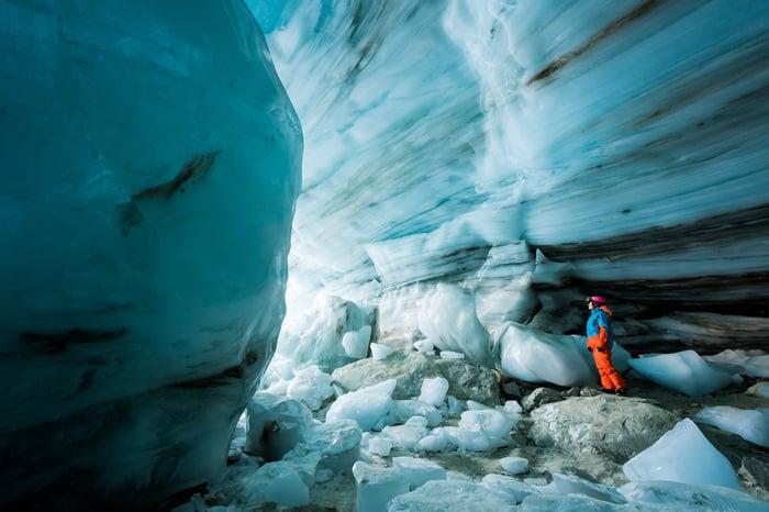 Person exploring a glacial cave