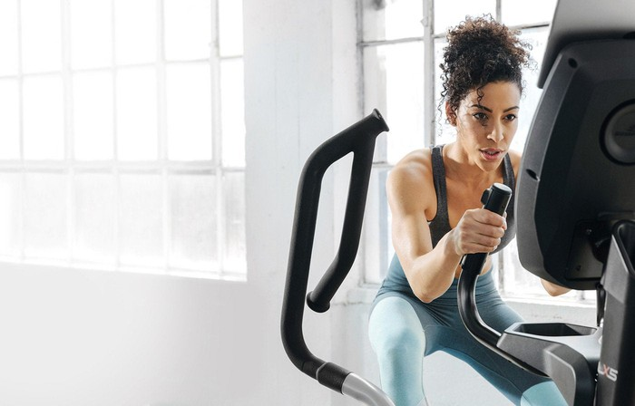 Woman on a piece of exercise equipment