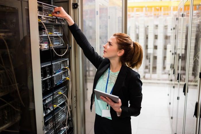 An engineer testing a data center server tower.