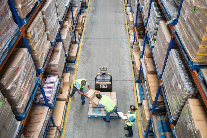 Warehouse workers managing inventory.