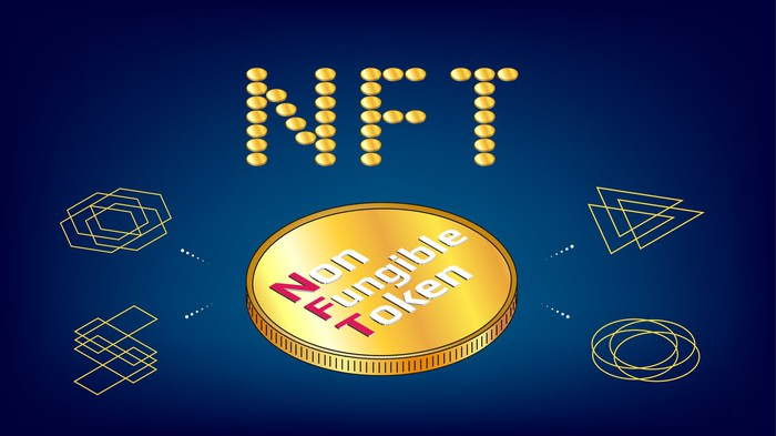 A gold coin that says Non Fungible Token on it.