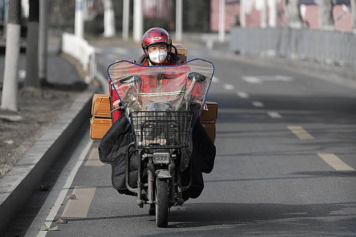 A JD.com delivery man making the rounds in the city of Wuhan.