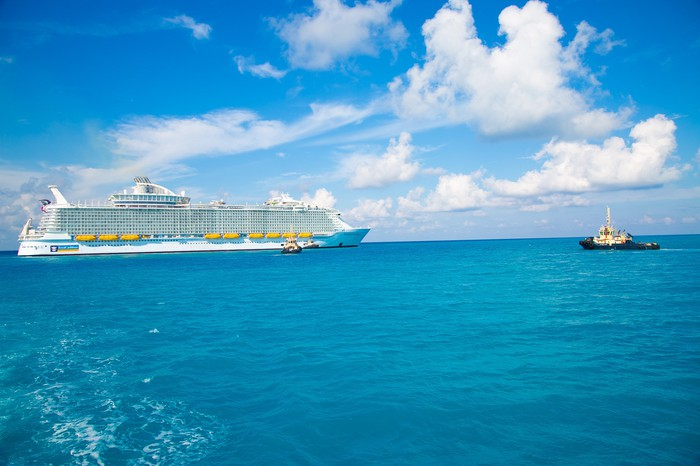 Royal Caribbean ship with tug boat approaching port