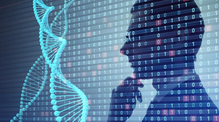 Person looking at double helix of DNA.