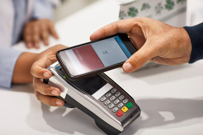 Someone paying with smartphone at register