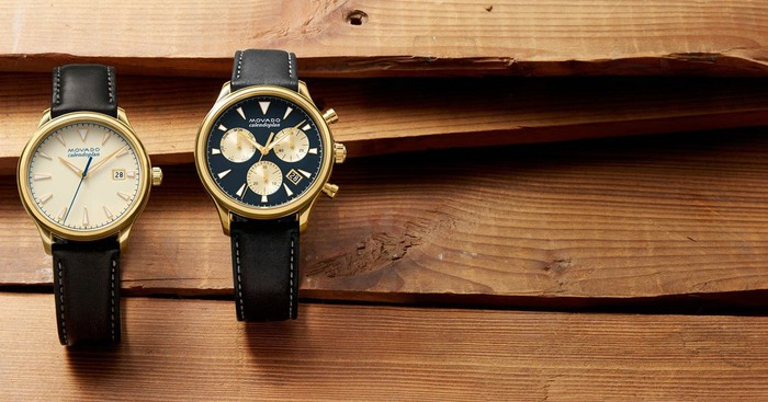 Two Movado watches on a wooden plank table.