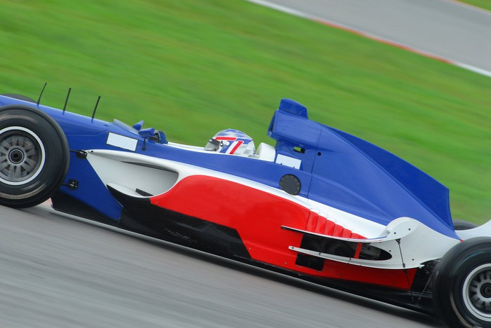 Formula 1 racecar in French colors red, white, and blue.