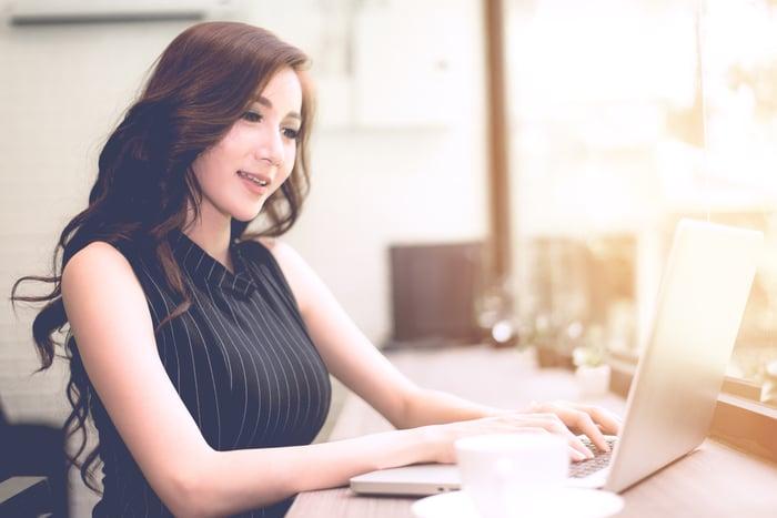 A woman using a laptop computer.