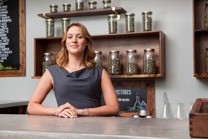 Woman smiling in a dispensary shop.