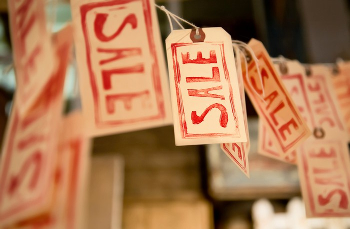 Sales labels hanging from a line