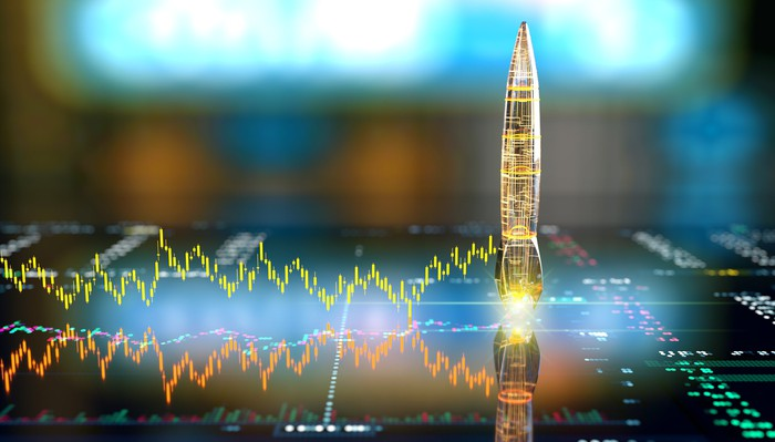 A digital rocket ship ready to launch from a choppy stock chart.