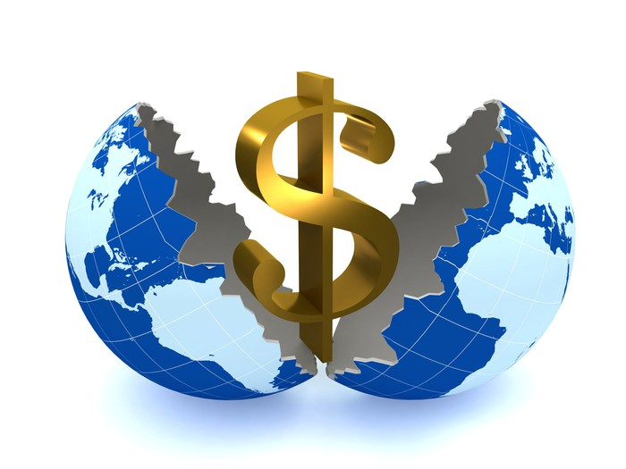A money sign coming out of a globe split in two.