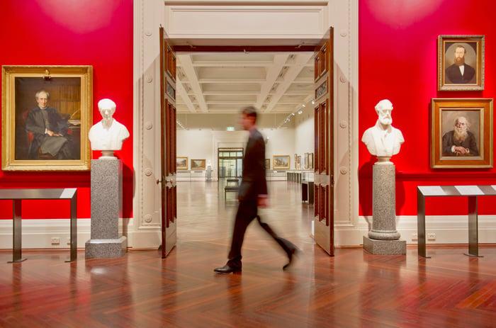 A security card walks through an art museum.