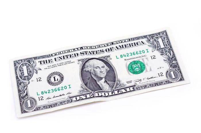 One dollar bill lying flat.