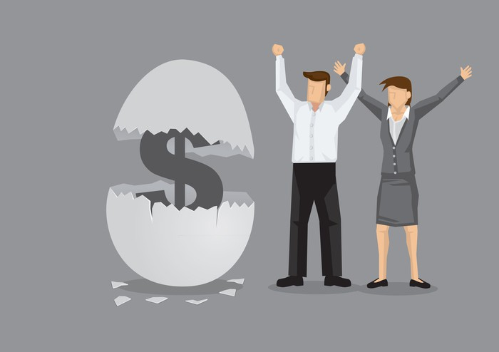 A cartoon man and woman stand next to a large egg that is hatching a dollar sign.