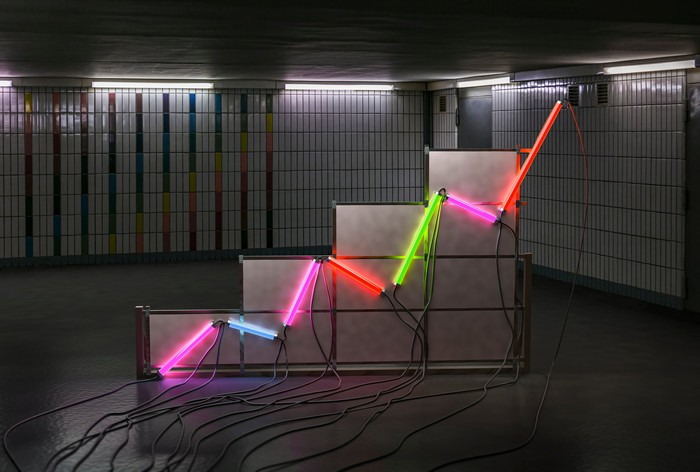 A rising graph made from neon light tubes.