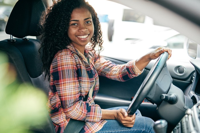 Woman driving a car.