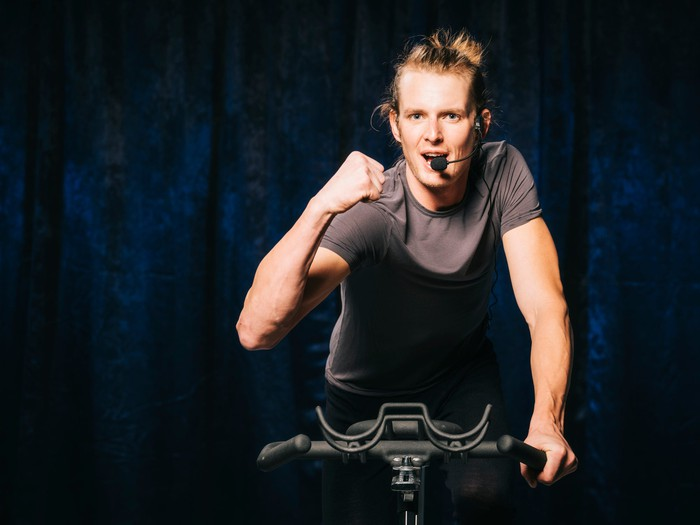 An activity leader on an exercise bike.