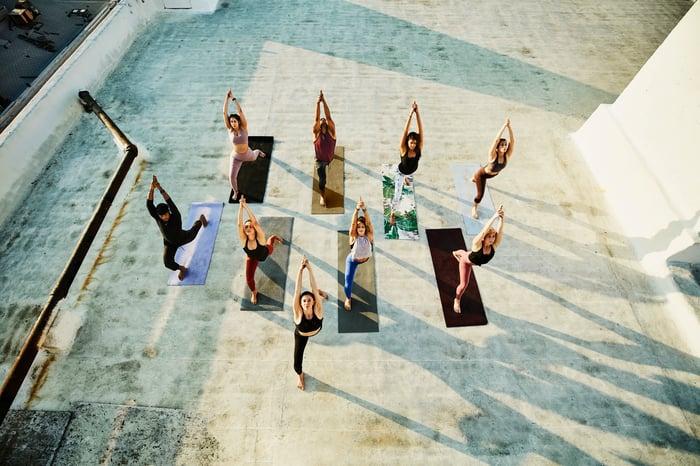 A yoga class outdoors.