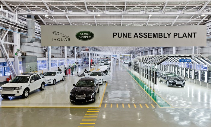 A 2013 file photo showing completed vehicles at Jaguar Land Rover's factory in Pune, Maharashtra state, India.