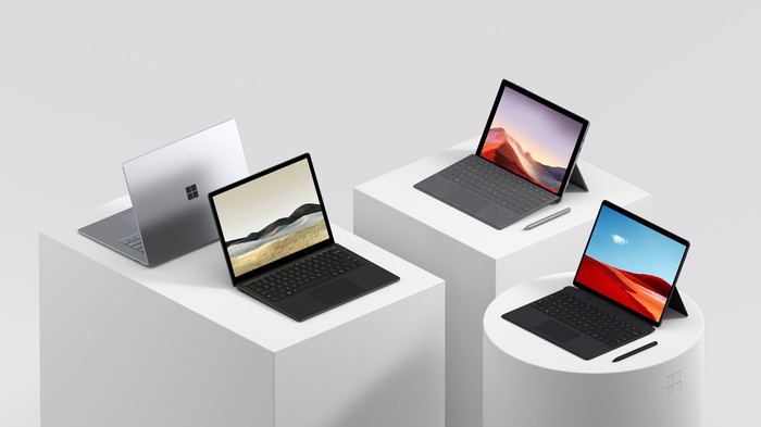 Four Microsoft surface computers.