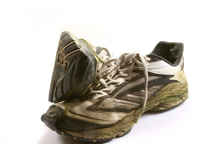 A pair of well-worn running shoes.