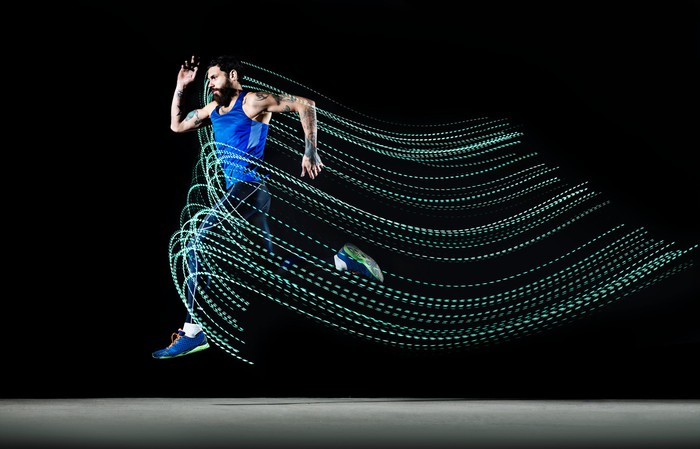 Male runner leaping through the air with speed