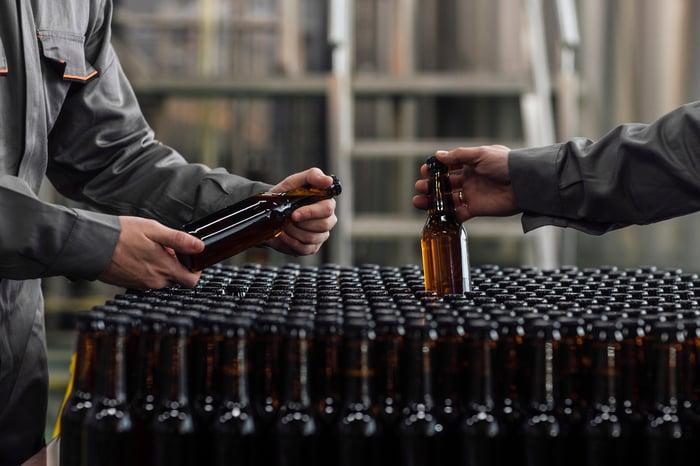 Bottles of unlabeled beer at a distribution center.